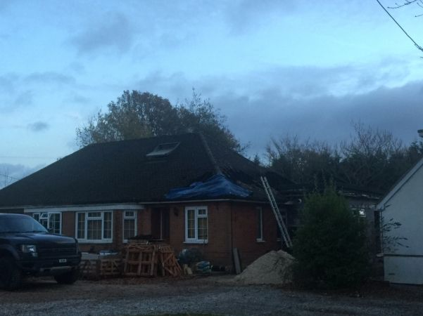 Fire Crews Tackle Serve Roof Fire  At Bungalow Near Winchester