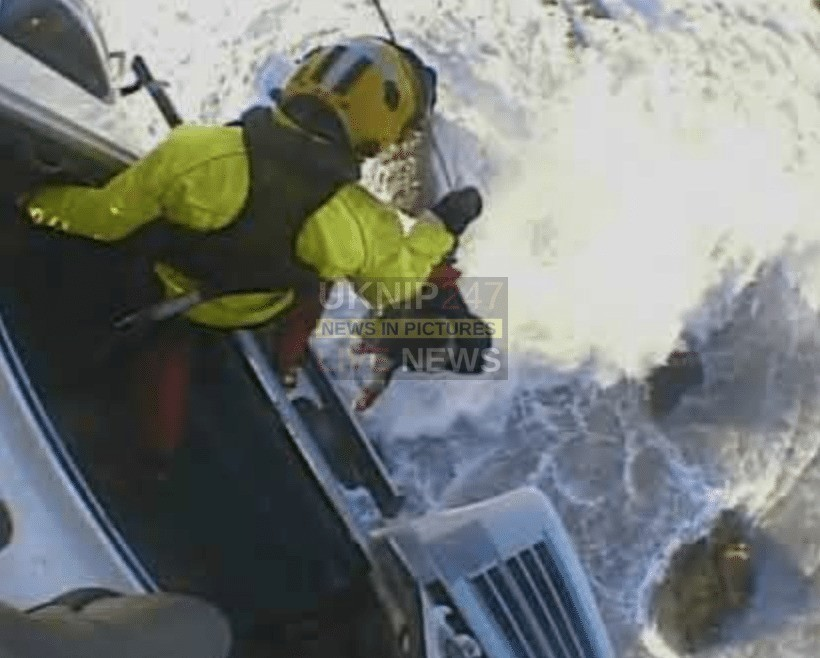 Incredible Scenes Of Coastguard Winchman Battered By 6ft Waves During Dramatic Rescue