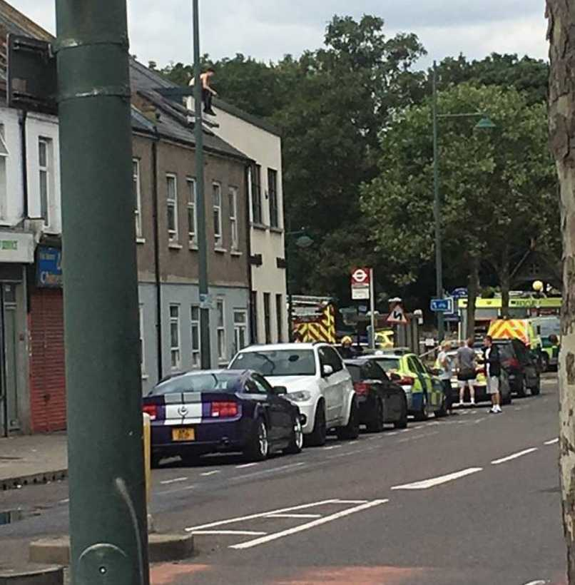 eirth street closed after man takes to roof