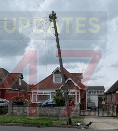 the dramatic moment after a car loses control and wipes out telephone pole in portchester